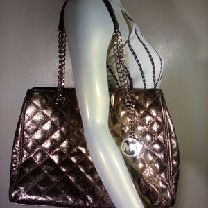 Micheal Kors-Price reduced !Leather Metallic Purse